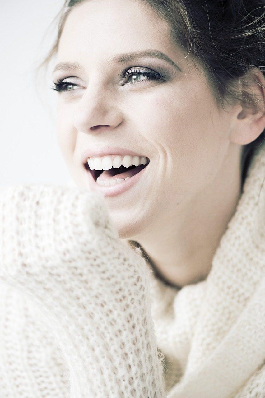 woman smiling smooth skin